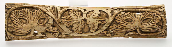Plaque Decorated with Stylized Vine Leaves