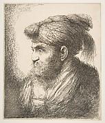 Man weraing a turban facing left