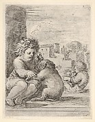 Child teaching a dog to sit, the child seated to left against a wall, teaching the dog to sit on its hind legs, another child embracing a dog to right in the background