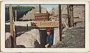 Card No. 222, A Bathroom in the French Trenches, from the World War I Scenes series (T121) issued by Sweet Caporal Cigarettes