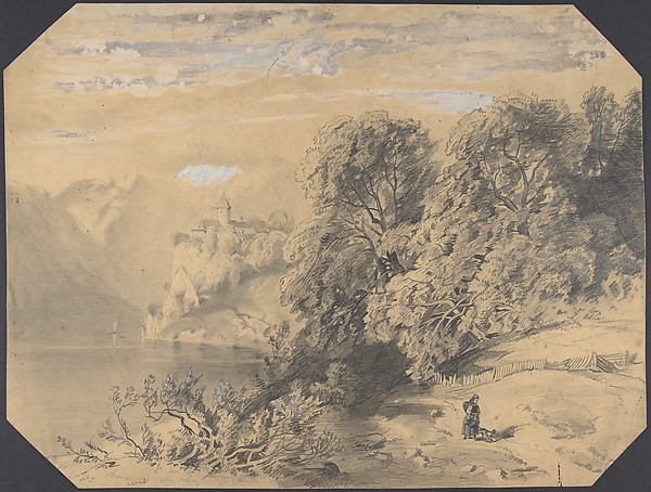 Woman with a dog by a mountain lake