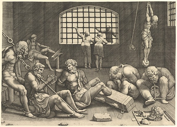 The Prison; a group of men in a dungeon bound in chains and shackles; to the right a figure hanging from his arms, tied to a boulder