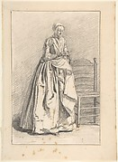 A Woman Standing next to a Chair