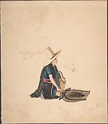A Woman Kneeling Selling Produce