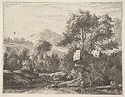 Two men standing ankle-deep in a body of water with a rocky outcrop behind them, to the left a rocky bank, trees and a hilltop beyond