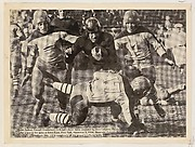 Walter Switzer, Cornell Quarterback shown being grounded by three Columbia Players, from the