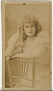 [Actress posing on chair], from the Actors and Actresses series (N145-8) issued by Duke Sons & Co. to promote Duke Cigarettes