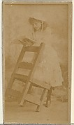 [Actress reading book while leaning on chair], from the Actors and Actresses series (N145-8) issued by Duke Sons & Co. to promote Duke Cigarettes