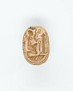 Scarab with a kneeling figure before an obelisk