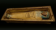 Mummy of Tasheriteniset with mummy mask and other cartonnage elements, also with garland of plants