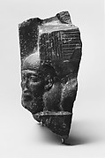 Fragment of a sculptured statue base depicting an Asiatic prisoner