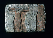Relief fragment with a male figure