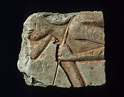 Relief with a stooped workman