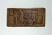 Part of a bronze statue base inscribed in Egyptian and Greek