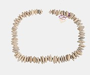 Necklace of  white lenticular beads