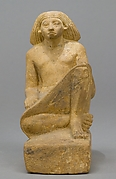Statue of an asymmetrically seated man