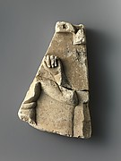 Fragment of relief plaque with a child god, inscribed on reverse