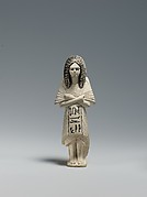 Shabti of the Scribe Huy wearing a Bat-pendant