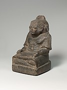 Statue of a scribe with a baboon