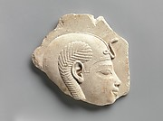 Relief head of a child god