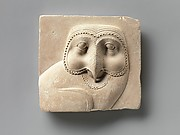 Relief plaque with face of an owl