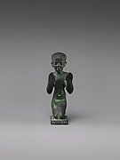 Statuette of an adorant from a group with a god