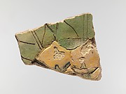 Tile with persea fruit and leaves
