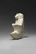 Figure of baboon on a basket and with a pillar, the shebet offering