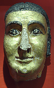 Mask of a woman with cosmetic lines and gilding