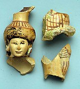 Fragments of a vase in the form of a woman holding a basket