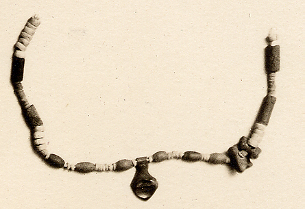 Necklace of beads and amulets