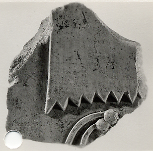 Relief showing part of a sun shade and a necklace - see 26.3.353-3