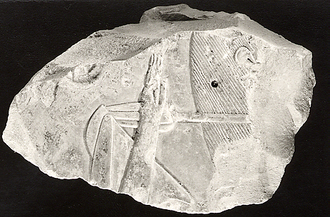 Relief from the tomb of Queen Neferu: female attendant carrying a sunshade (see 26.3.353-1)