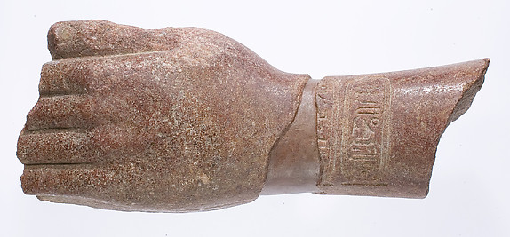 left hand and arm fragment with Aten cartouches from a statue supporting a stela?