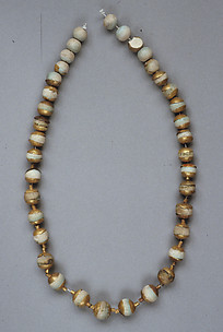 Globular Beads with Caps, Strung as a Necklace