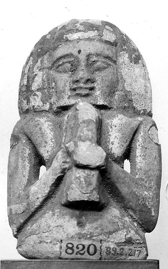 Female figure playing a lyre