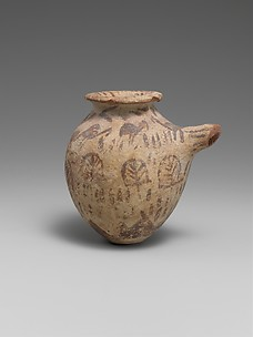 Spouted vessel in decorated ware