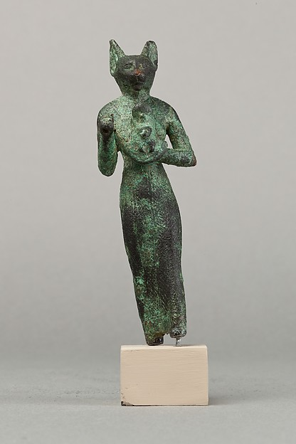 Bastet, a scarab between her ears, holding an aegis