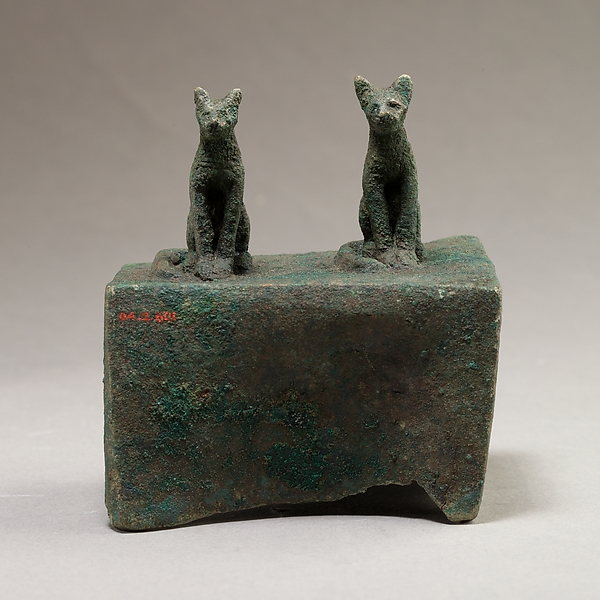 Two cats surmounting a box for an animal mummy
