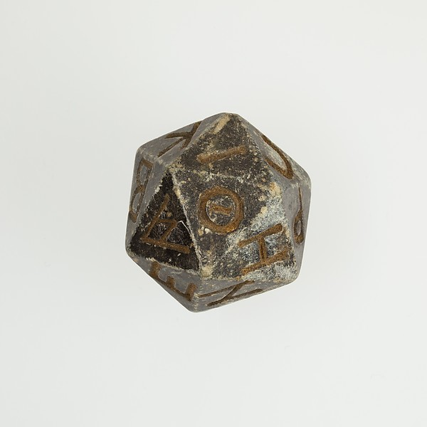 Twenty-sided die (icosahedron) with faces inscribed with Greek letters