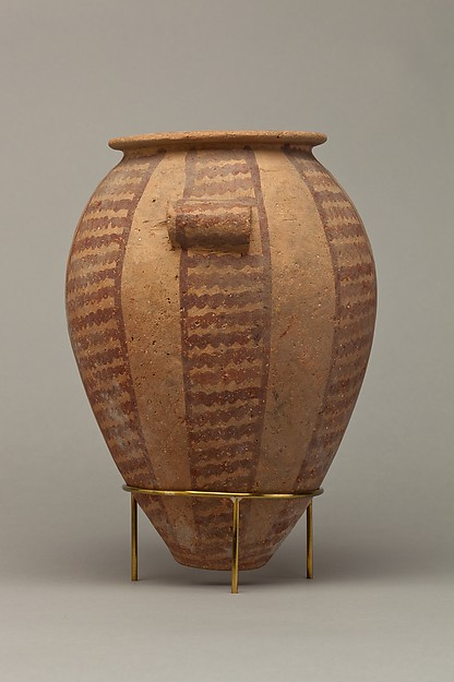 Decorated ware jar with vertical bands of wavy lines