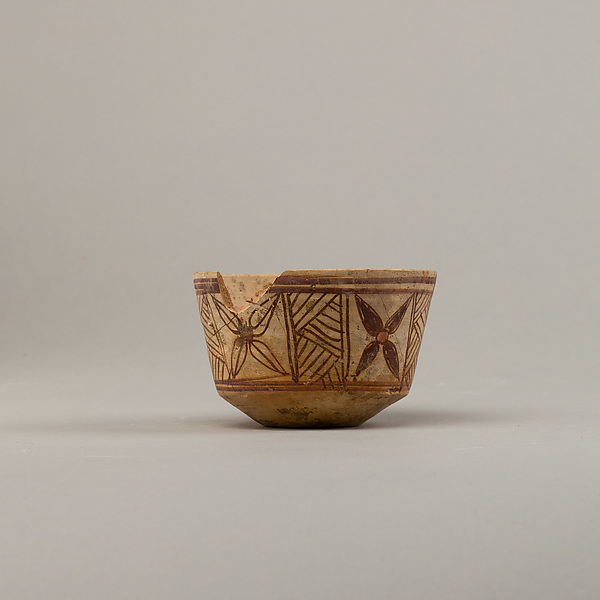Bowl with floral and geometric designs