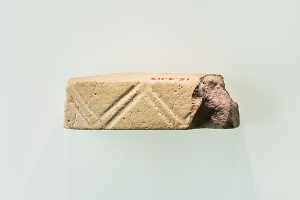 A fragment of a cubic unknown object, possibly a fragment of a rod