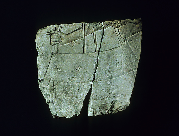 Relief with attendant holding an offering table