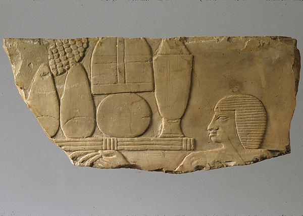 Relief with head of an offering bearer and offerings