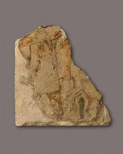 A relief fragment of a man carrying an ostrich