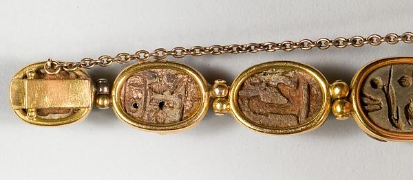 Nine scarabs set in modern bracelet.