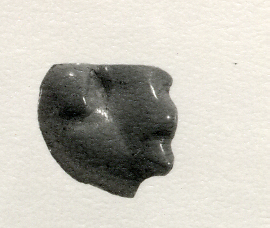 Inlay element from shrine: lion head