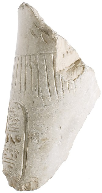 Arm with garment fringe, pleating and Aten cartouche