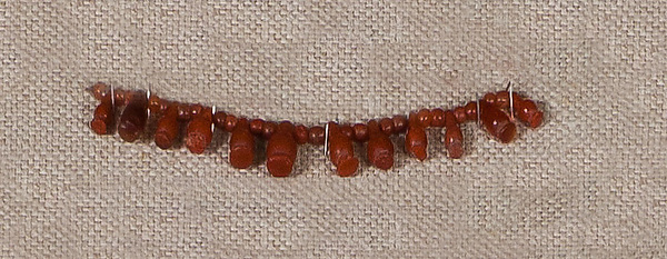 String of Carnelian Beads and Poppy Pendants
